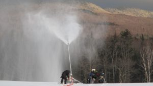 snowmaker adjusting snow gun