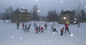 kids on skis during snowstorm