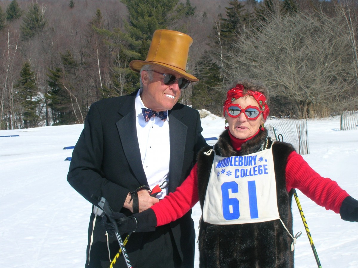 Nordic skiing couple dressed in black tie.